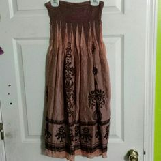 Sun dress/Skirt Worn maybe twice. Can be worn as a strapless dress or a skirt. There are buttons underneath if you want a bunched look. The tag says one size but I think it fits more like a small or medium. Dresses Strapless