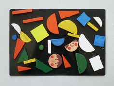 Magnets; or felt? Reminds me of Colourforms C had.