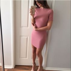 Mini blush dress brand new Beautiful soft pink stretch mini dress, never used, brand new from boutique, bought as retail new item so it doesn't have tags.  Runs small, fits like a medium but tag says large. Boutique Dresses Mini
