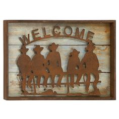 Wood and metal wall decor with a Western theme.   Product: Wall décorConstruction Material: WoodColo...