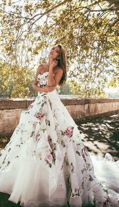 The floral pattern wedding dress is very unique and pretty; click to see more fabulous white wedding ideas; Featured: Alessandro Angelozzi