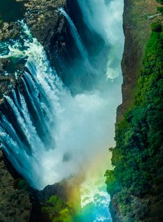 """Here's the famous Victoria Falls, which separates Zambia from Zimbabwe. It's considered the """"largest"""" waterfall because of it's combined width and height. which means it's the biggest """"sheet"""" of waterfall in the world. Hdr Photography, Street Photography, Hd Galaxy Wallpaper, Rainbow Waterfall, Largest Waterfall, Victoria Falls, Beautiful Waterfalls, Landscape Art, Dream Vacations"""