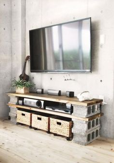 minimalist living room with concrete wall and diy tv furniture made of wood panels and b … - DIY Furniture Ideas Tv Furniture, Furniture Making, Wood Tv Unit, Ideas Geniales, Concrete Wall, Concrete Blocks, Home Staging, Contemporary Decor, Interior Design