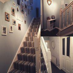 New duck egg blue hallway, striped carpet.