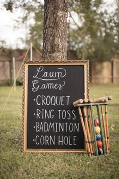 I love the idea of having a sign with all the reception lawn games listed. Would be pretty cheap to make with chalkboard paint, a thin sheet of wood, and an old frame.