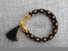 Hey, I found this really awesome Etsy listing at https://www.etsy.com/listing/285661371/black-and-gold-bracelet-seed-bead
