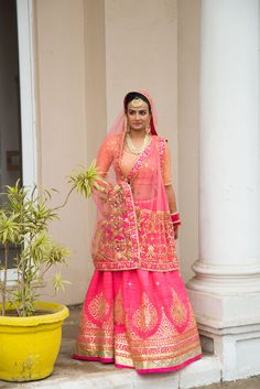 Real Indian Weddings - Ankita and Ryan | WedMeGood | Pink and Orange Gota Patti Bridal Lehenga with a Polki and Gold Set Picture Courtesy: Shiv Sharma Photography #wedmegood #bridal #gotapatti #pink