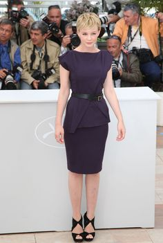 Carey Mulligan in an architectural dark purple sheath. So chic for a more formal office look.
