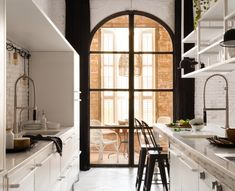 MARTA CASTELLANO STUDIO AND SERRAT-TORT ARCHITECTS White, nordic, romantic and industrial kitchen in Barcelona apartment