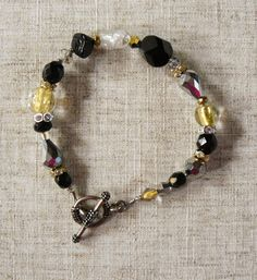 Black and Gold Hand Blown Glass Bracelet  Materials: Sterling Silver Toggle, Hand Blown Glass, Rhinestone, Glass Beads