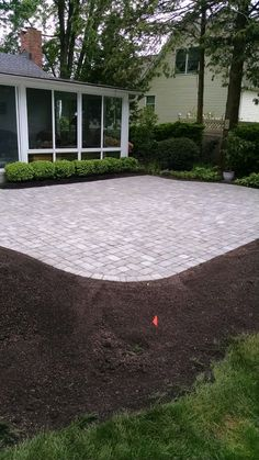 a mix of concrete pavers and bluestone flagstone patio set in