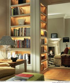 Great bookshelf with lighting - A great way to transition from one room to the next