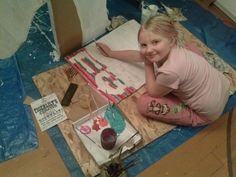 little helper painting the circus sign.