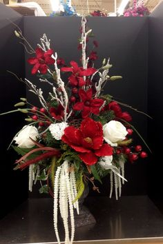 traditional red and white urn arrangement