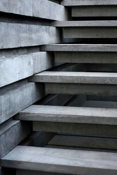 """concrete: sure footing"". Interesting staircase concept."