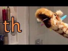 Geraldine the Giraffe learns the /th/ sound.