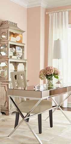 Blush walls, Asian etegere in a painted finish, mirrored desk, sheers