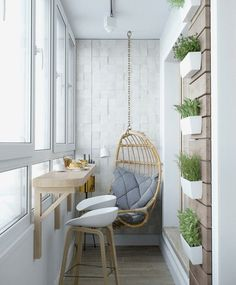 A great example of how space is not always a restriction on creating something beautiful for your home. We love this little balcony nook with wall mounted plants, an attached breakfast table and a lunging swing. Interior Design by Urbanclap Professional: Twinkle of Emotional Interior and Architecture #interior #interiors #interiordesign #interiordesignindia #interiordesigner #balcony #plants #mountedplants #swing