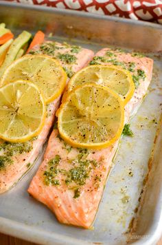 Simple Delicious Lemon and Herb Butter Salmon Traybake - succulent salmon fillets with the flavours of garlic, herbs and butter. Gluten Free, Slimming World and Weight Watchers friendly #slimmingworld #weightwatchers #traybake #salmon