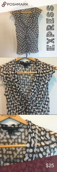 "Express Silk Neck Tie Top - Sz S - Retail $60 Express silk sleeveless sheer top. Black with white dots throughout.  V-neck with tie at bust. Excellent used condition. Material: 100% silk. Measurements: 27"" length, 20"" bust. Size Small. Retail $60.  ✅Always Authentic✅ ⬇️Bundle & Get 10% Off & Save on Shipping⬇️ ❌Trades❌PayPal❌ Express Tops Blouses"