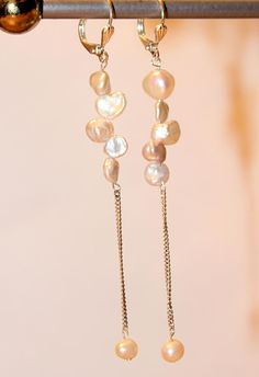 PEARL DANGLE EARRINGS Price: $155