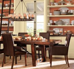 Warm and inviting dining room in fall colors with walls painted in Mellowed Ivory
