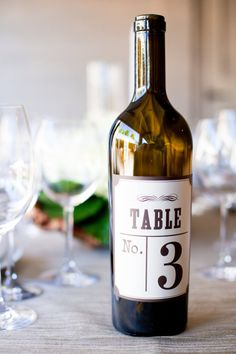 Wine bottle table numbers- @Erin B Campbell with the wine cork place card holders could be cute... means we would need 75 - 80... get to drinking people!