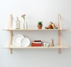 assemblages, leather strap shelf