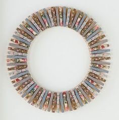 Create an easy and unique wreath using clothespins decorated with washi tape.