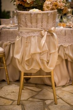 Gold wedding chair cover looks like a little dress for your chair!