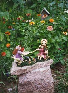 Original cornhusk doll by Patty Frisbee - tug of war.