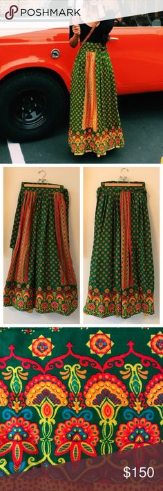 """Vintage Ellen Tracy '70s Boho Maxi Wrap Skirt S/M This vintage skirt by Ellen Tracy is incredible & so rare!!! The gorgeous art nouveau print is rendered in vibrant oranges, green, yellow & turquoise. Flowers, stars & paisley, oh my! This skirt has 2 layers, & the calico petticoat adds volume & peeks out in a ruffle at the hem. Size 13 but fits like S/M. EUC-only 2 small flaws (see pics). Perfect for a festival w/a tight tee & clogs. Hippie chic! Waist: 26-27; Hips: Full; Length: 38.5""""…"""