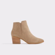 Larissi Look sassy in these suede booties with wood styled heels. So versatile they can be worn all year long.