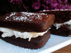 Simple Homemade Suzy Q's consist of a marshmallow fluff filling sandwiched between devil's food cake.
