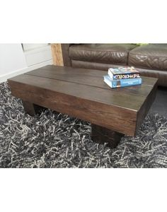 A 3 board square modern style coffee table in solid dark oak but