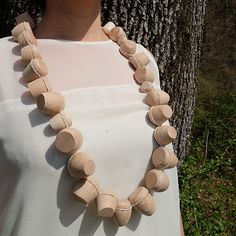 "ISABELLE HERTZEISEN-CH Necklace: Untitled, 2014 Pearls, Wood, Silk thread Project: ""Ultima Forsan"", 2014"
