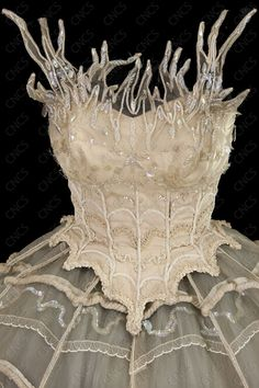The delicateness and lightness of embroidery in this piece creates the feel of fragility. The light cream colours and see through chiffon materials against the curved and smooth edges enhances the fragile essence of the piece. I bet it would look incredible in flame colors too!