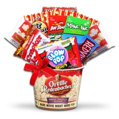 There's no better way to get into the holiday spirit then by watching classic holiday movies! Whether its Rudolph or Frosty the Snowman, no movie night is complete without delicious Holiday Movie Night treats! This Popcorn Tub comes complete with Orville Redenbacher Popcorn, Popcorn Scoop Containers, Tom Clark's Original Caramel Popcorn, Red Vines Licorice, Blow Pop Mini Christmas Tree Lollipops, Mike & Ike Original Candies, Hot Tamales Candies, and Cracker Jack Popcorn.'