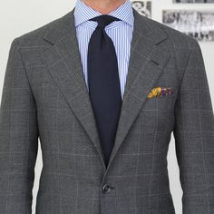 grey windowpane suit blue striped shirt solid tie