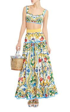 This **Dolce & Gabbana** maxi skirt features a feminine ruffled hem and contrast waistband.
