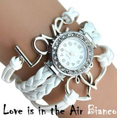 """Bracelet watch made with interwoven ropes. It includes, besides the watch, two hearts and the word """"love""""."""