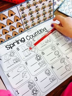 Spring Counting. Students count each set of objects and then compare the numbers to see which one is the least.