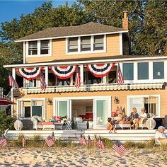 This sunny yellow cottage on Lake Michigan exudes summertime happiness. Great 4th of July decorations! Coastalliving.com