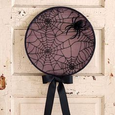 Web Door Hanger - Black spray painted embroidery hoop, web fabric, topped with a giant spider