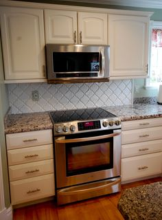 The backsplash is the Beveled Arabesque ceramic tile in white from Mission Stone and Tile. These are really beautiful tiles.