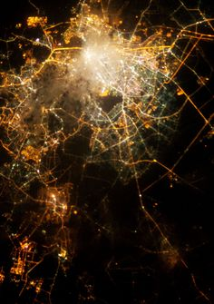 City lights photographed from the International Space Station and Neurons imaged with fluorescence microscopy.