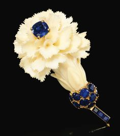 1950s ivory and sapphire flower brooch by Cartier.