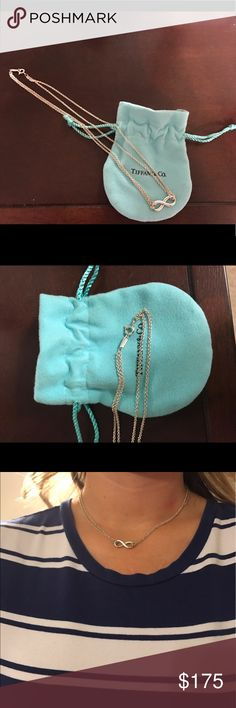 """Tiffany & Co. Infiniti Necklace Worn maybe twice! Includes blue jewelry pouch. No damages or wear (has been stored in blue pouch). 16"""" chain. Tiffany & Co. Jewelry Necklaces"""