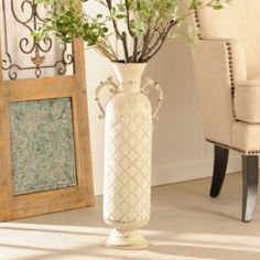 Perfectly fit your tall stems into this Ivory Distressed Metal Vase. This embossed, urn-shaped vase is perfect for adding color to your charming décor! #kirklands #SweetSimplicity