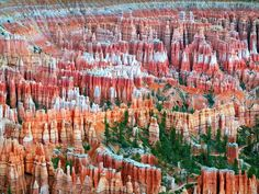 Bryce Canyon's layered red and orange rock pillars, known as hoodoos, make it a can't-miss destination for campers and shutterbugs alike.
